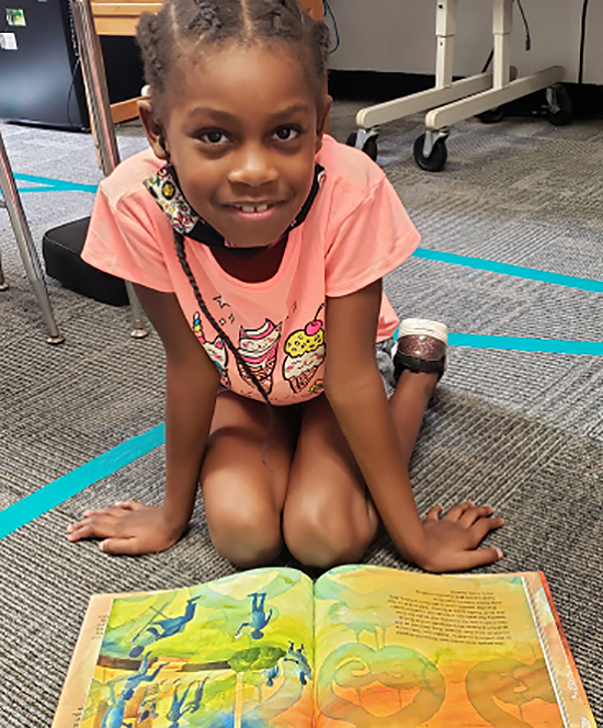 A child enjoying a book from the 2020 festival